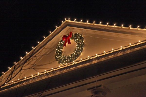 Christmas lights and decorations on a house roof