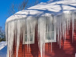 Ice dams and snow on roof and gutters