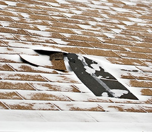 Winter Storm Damaged Roof Shingles