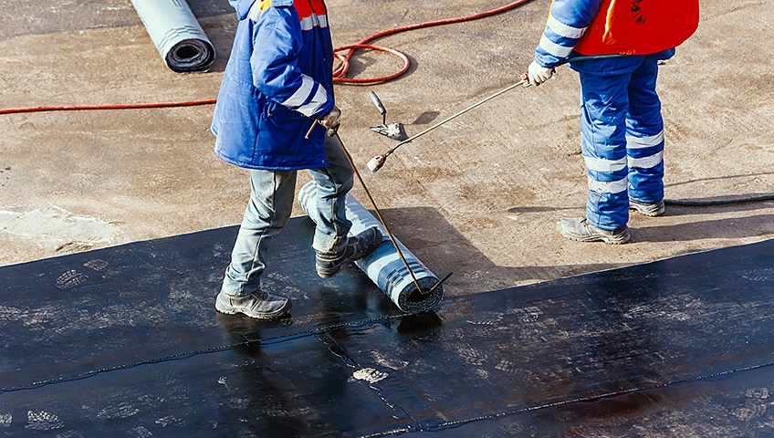 The Right Time to Repair or Replace a Commercial Flat Roof